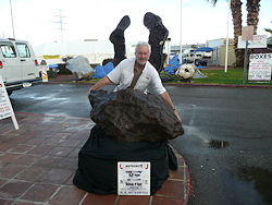 Barry placing a 2.2 Metric Ton Campo del Cielo individual on display in front of Inn Suites in Tucson