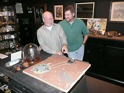 Our resident artist, Jerry Armstrong, showing Sean his Mars lander diorama