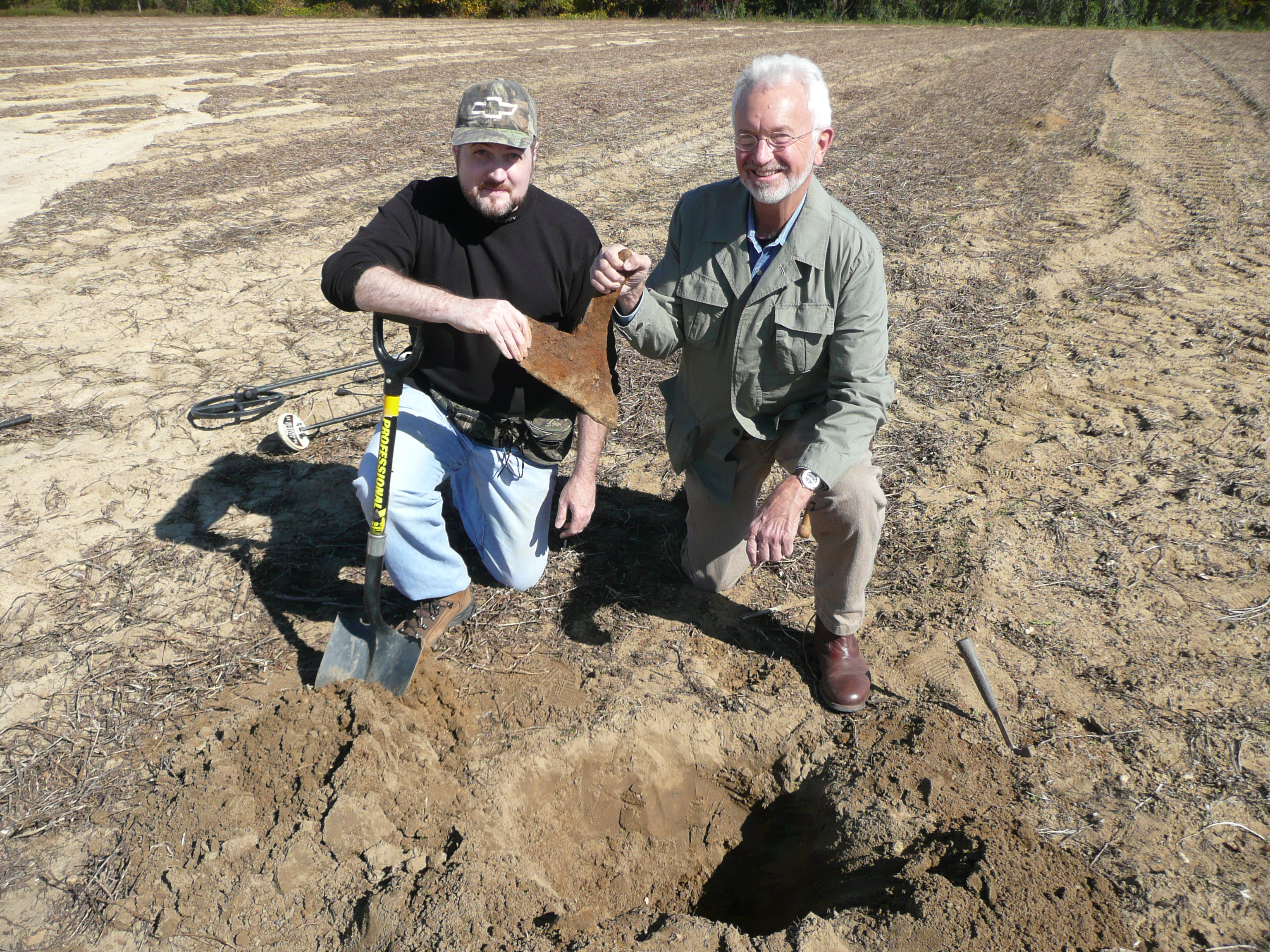 Sean and Barry in the field with a newly-recovered, flight oriented plow point